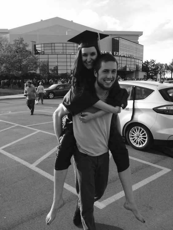 boyfriend carrying his girlfriend on his back on her graduation day