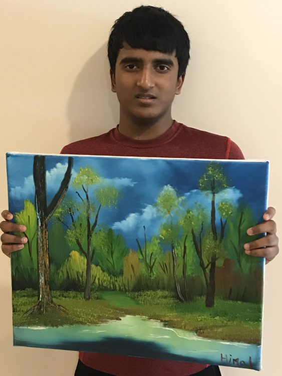 Himal Bikmal with his painting of a forest