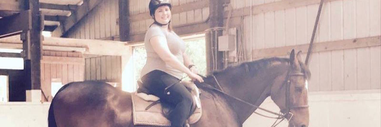 Woman riding a horse.