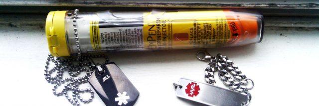 a woman's epi-pen and medical bracelets