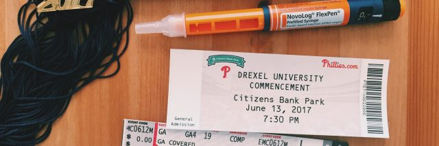 graduation tassel, ticket to ceremony and epi pen for diabetes