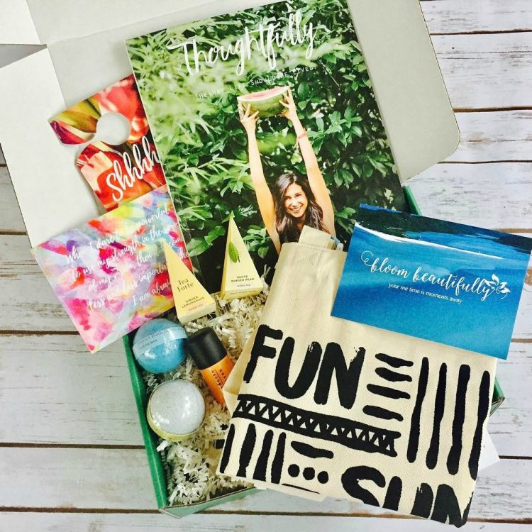 Beach themed box containing tote, body spray, and book