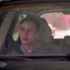 Sam, a teen with autism, in a car with his mother
