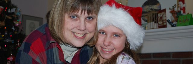 The author with her niece, wearing a Santa hat