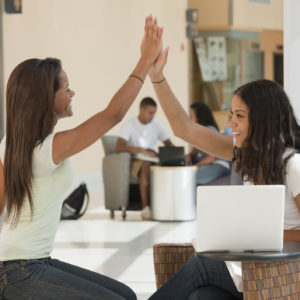 two women doing a high five