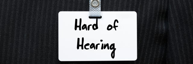 "Tag on suit that says ""hard of hearing."""