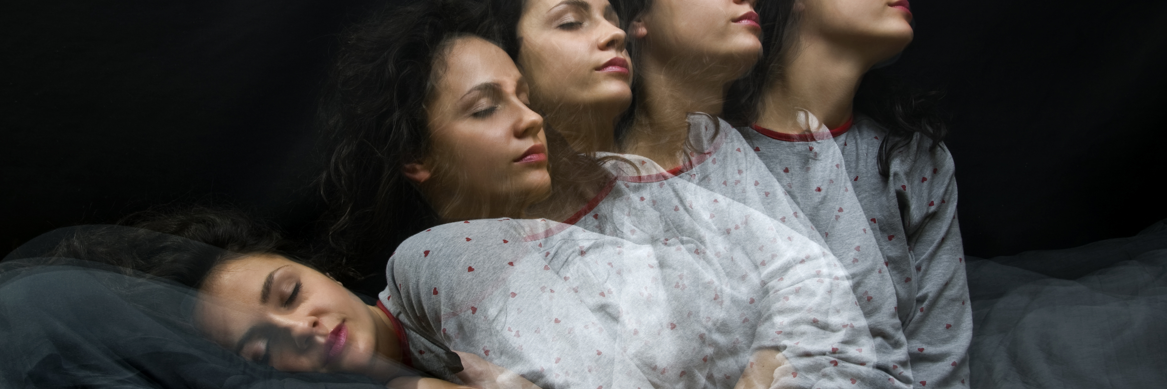 Multi-exposure of woman sleeping and waking up.