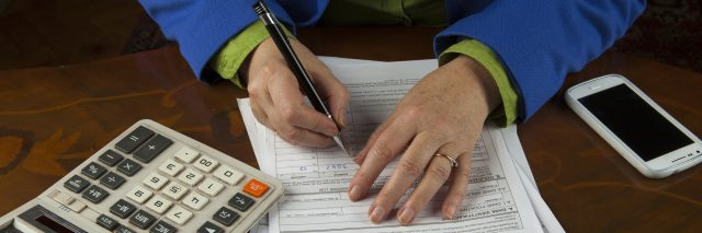 Woman filling out paperwork.