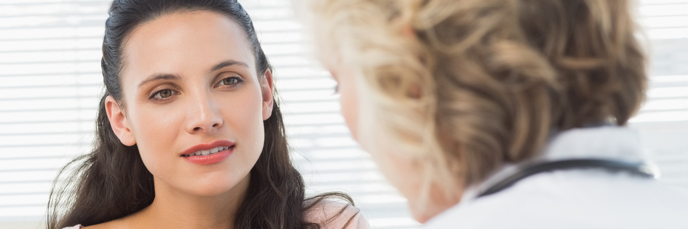 female patient talking to her doctor