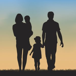 silhouette of family of four walking outside