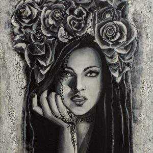 Black and white woman with a flower design on top of her head.