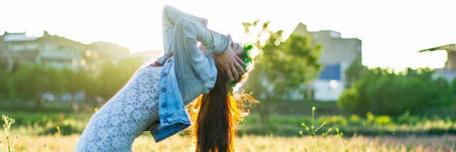 woman falling in a field
