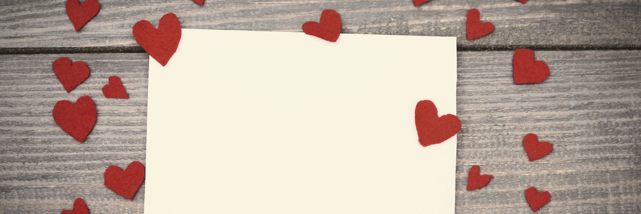 letter surrounded by red hearts