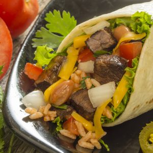 This burrito looks very tasty with beef, peppers and melted cheese. And now people with screen readers, you can join in being hungry.