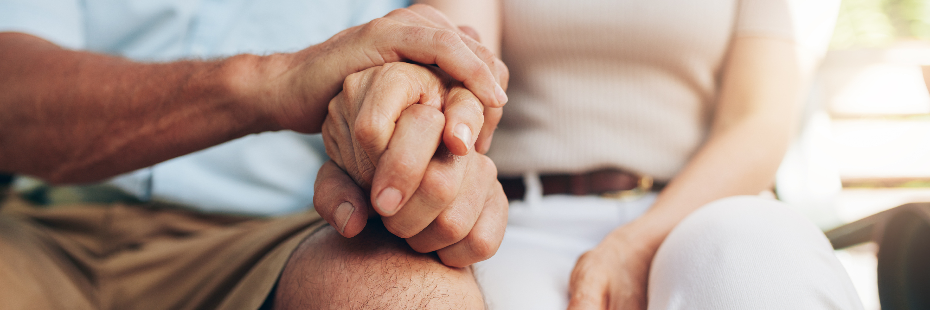 senior couple holding hands support