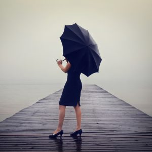 A woman with a black umbrella