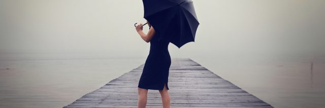 A woman with a black umbrella