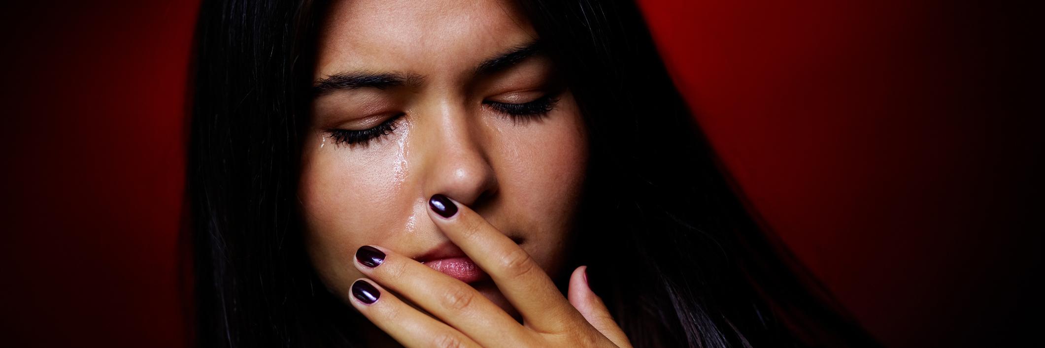 Latina woman crying.