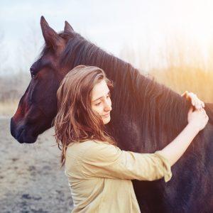 A woman hugging a horse