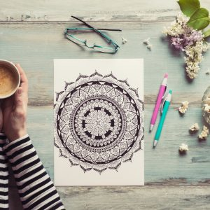 Flat lay, female coloring adult coloring books, new stress relieving trend