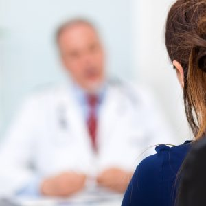 female patient talking to a doctor