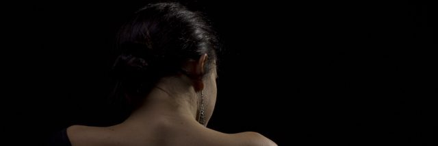 A woman with her back facing the camera.