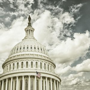 US Capitol with clouds.