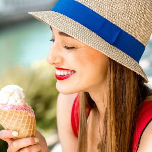 A woman enjoying an ice cream cone