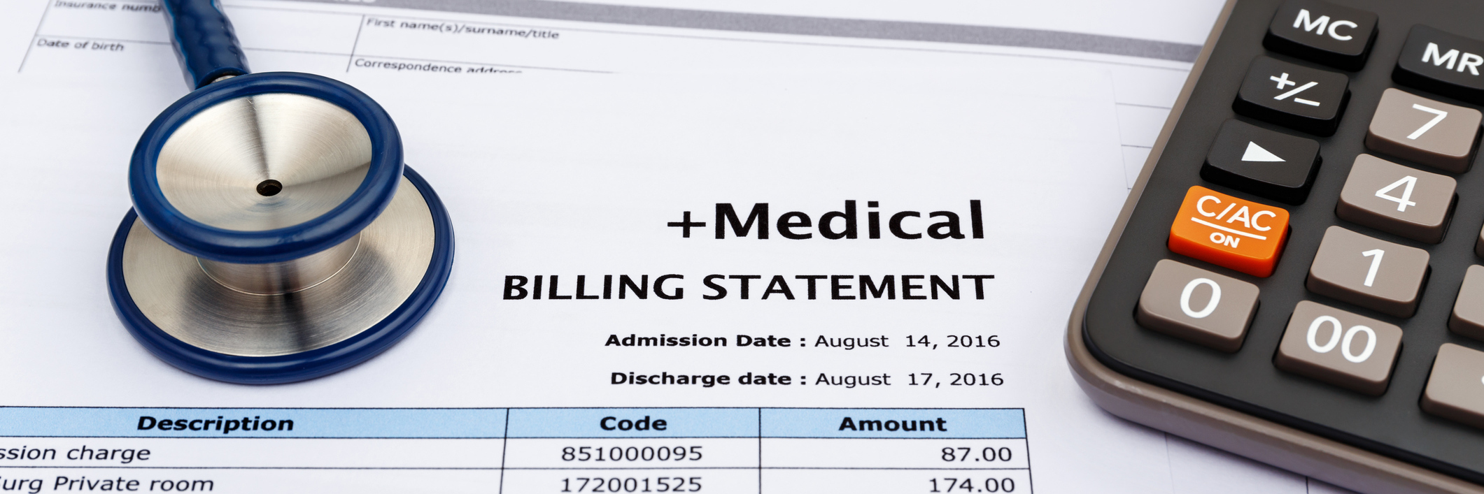 medical bill statement next to calculator and stethoscope
