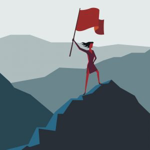 A woman with a flag on a mountain