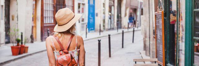 woman walking down a european street on vacation