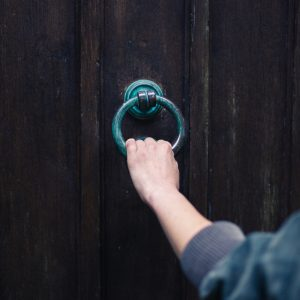 hand holing onto a door knocker