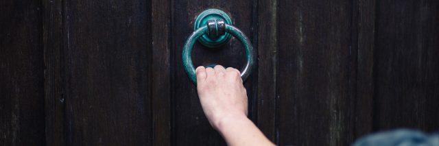 hand holing onto a door knocker