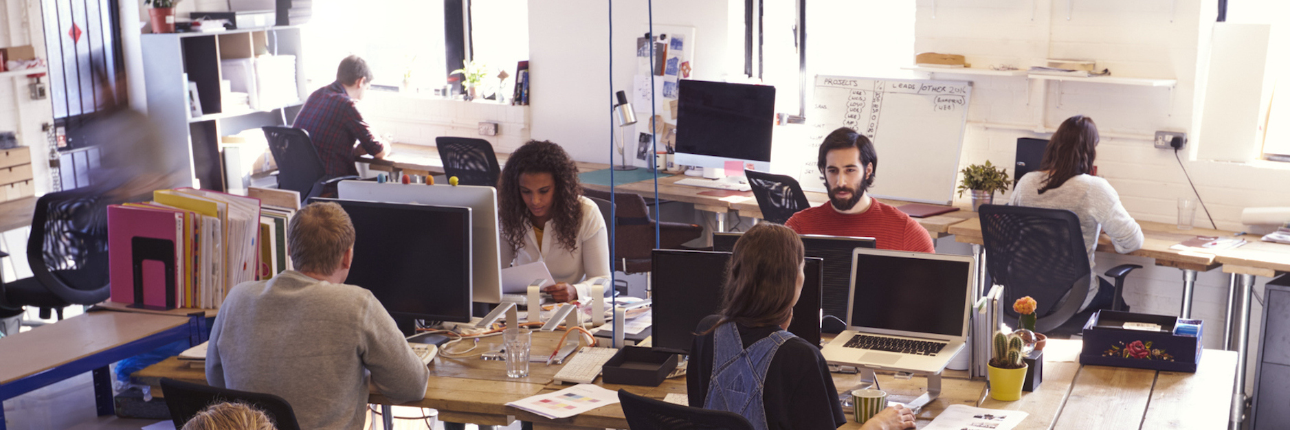 Employees working at desks in office