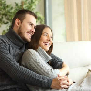 couple sitting and hugging on couch