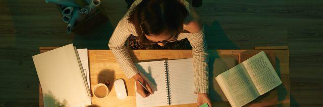Female studying at desk.