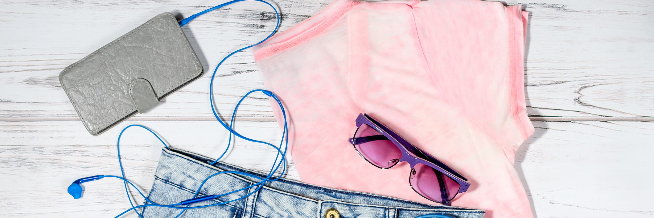 Female casual summer clothing collection overhead - clothes and electronics