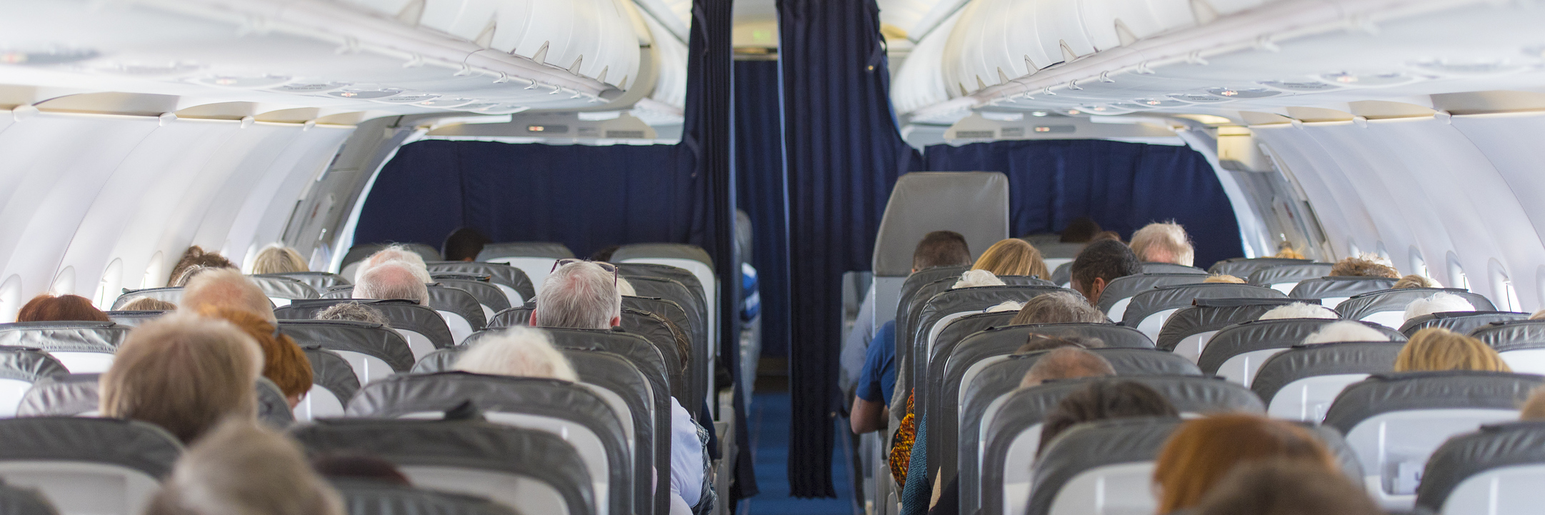 rows inside the cabin of an airplane