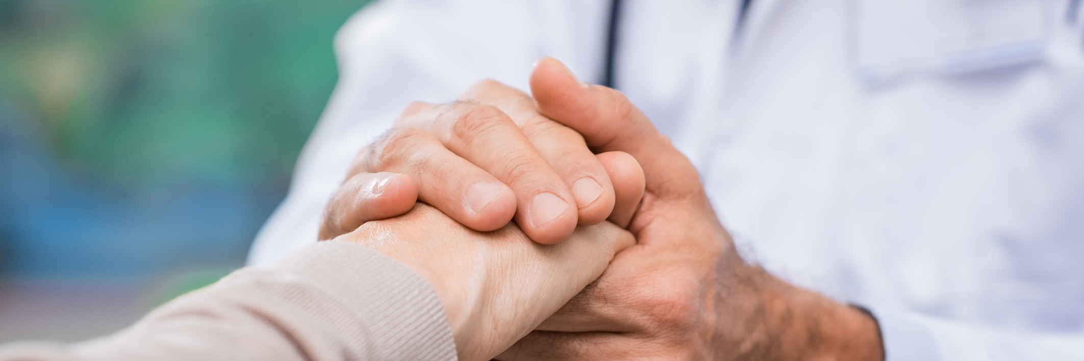 doctor holding his patient's hand