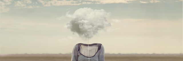 a woman whose face has been replaced with a cloud