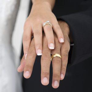 Hands of bride and groom.