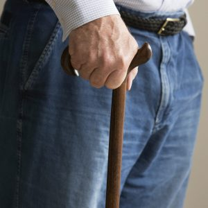 a man leaning on a cane