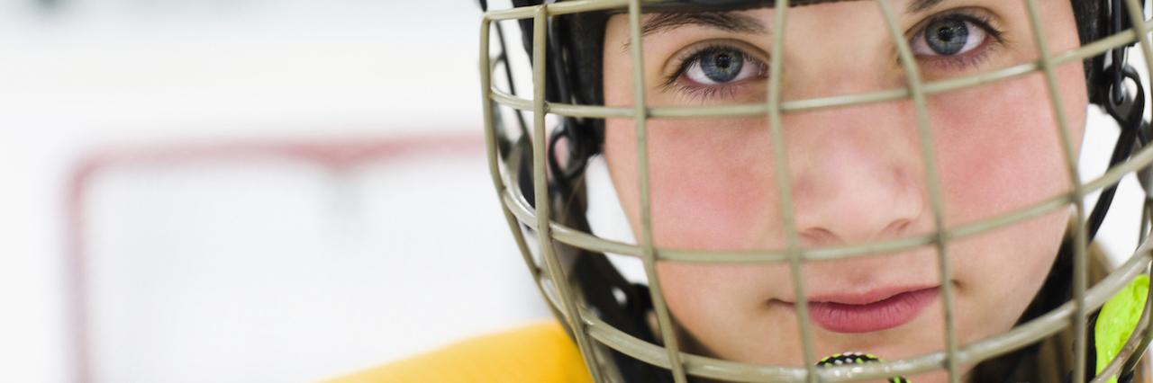 A woman playing hockey