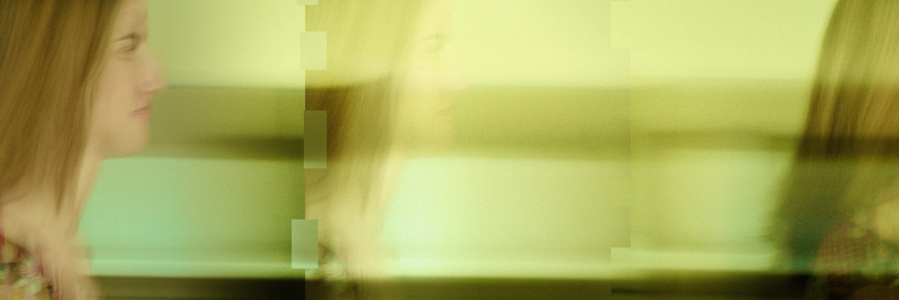 digital composite of yougn woman blurred walking through office