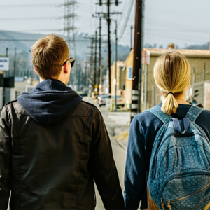 Young man and woman walking together.
