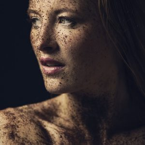 woman covered in dirt smiling