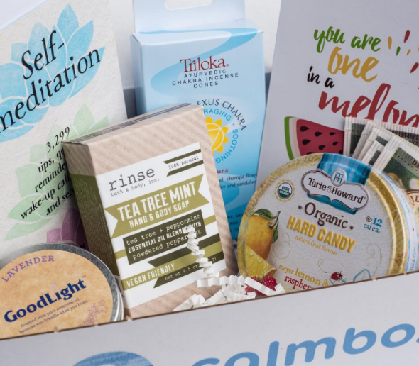 calmbox containing tea, food, and prints