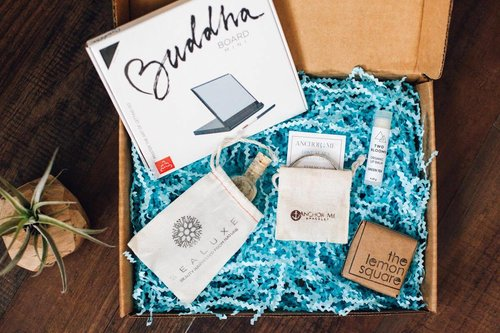 crate with blue confetti,buddha board, and soaps