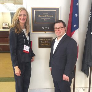 Courtney and her son outside their senator's office.