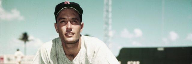 baseball player Jimmy Piersell looks at camera standing on baseball field